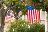 Front Porches with American Flags. - 205289105
