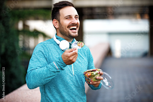 Man is eating vegetable salad - 205289722