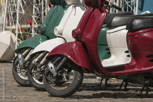 Canvas Scooter three mopeds painted in colors of the Italian flag