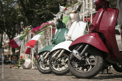 Fotobehang Scooter three mopeds painted in colors of the Italian flag