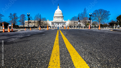 Fototapeta APRIL 8, 2018 - WASHINGTON DC - Yellow lines lead to US Capitol, Washington D.C.