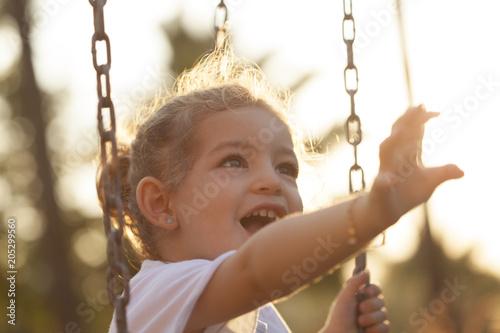 Fotobehang Amusementspark girl playing at public park