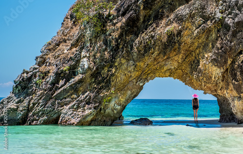 Beautiful girl in swimsuit at Lover's Gate on the Khai island, Satun, Thailand.