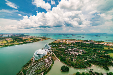 Aerial Panoramic View of Singapore City and Port under wonderful blue sky