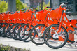 Quadro Portland bikes сity offers fans healthy lifestyle with orange bikes for trip in the city stand in row on rental network parking lot