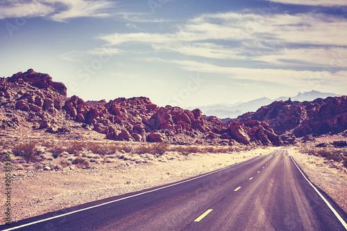 Fotobehang Aubergine Retro toned desert road, travel concept, Valley of Fire; Nevada, USA.