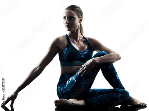 one caucasian woman exercising fitness Stretching excercises in silhouette isolated on white background