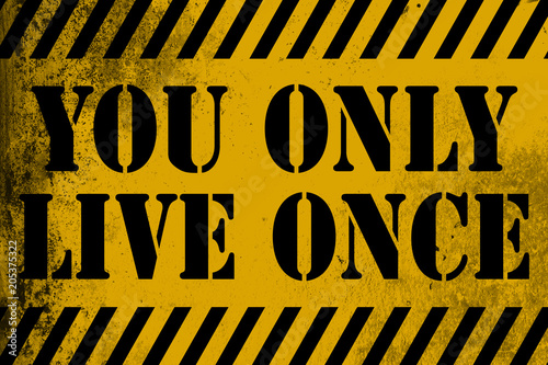 You only live once sign yellow with stripes