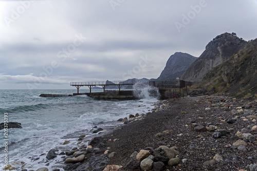 Plexiglas Lente Strong surf on an empty beach. Crimea