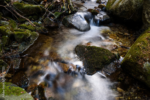 Beautiful small mountain waterfall in forest - 205377123