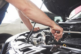 Auto mechanic working in garage. Repair service - 205382156