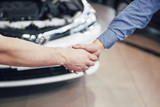 husband car mechanic and woman customer make an agreement on the repair of the car - 205384373