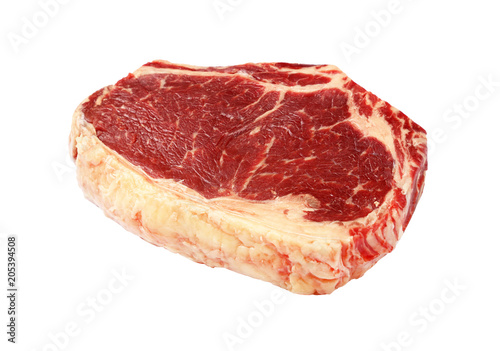 Plexiglas Steakhouse Close up raw beef ribeye steak isolated on white