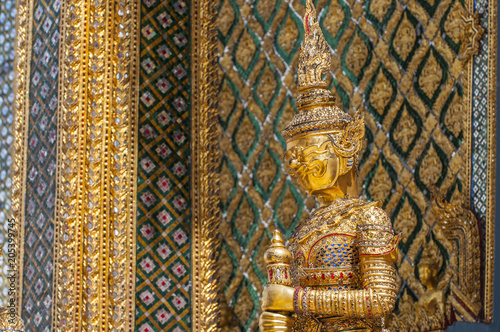 Mythical beast statue guarding the Phra Mondop library building on the grounds of the Grand Palace Bangkok Thailand.
