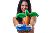 Woman in bikini holding inflatable palm tree toy - 205404997