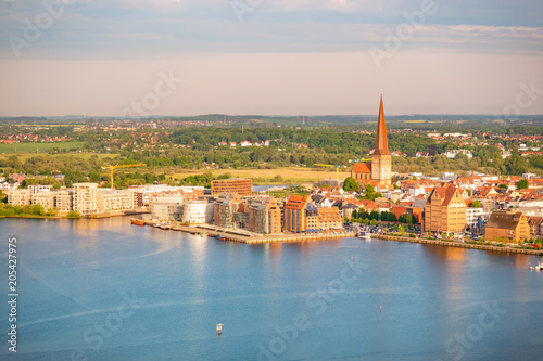 Poster aerial view of rostock and the river warnow in the evening - city harbor