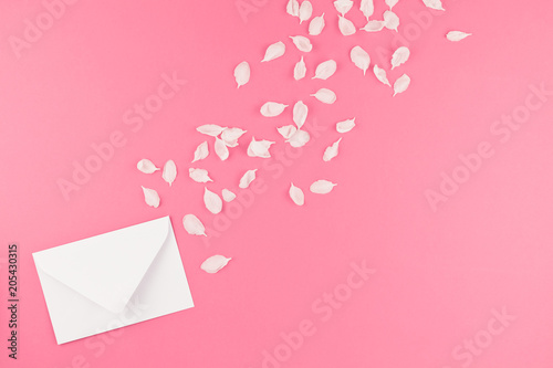 Foto Murales Flat lay of white letter mock up with petals