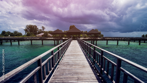 Fridge magnet Wooden Beach Dock or Wooden Pier at Beautiful Tropical Beach