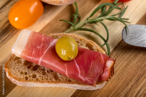 Thinly sliced German black forest ham. - 205438794
