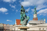 Neptune fountain with the city hall tower in the background on the Main Market (Rynek) square in the Old Town of Poznan, Poland