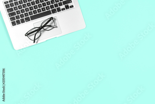 Foto Murales Office workplace Minimal flat lay mockup Laptop glasses blue