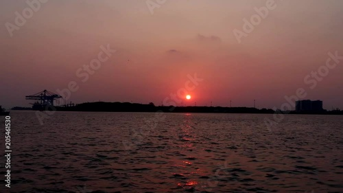 A timelapse of the sun setting over a lake in Kerala, India.