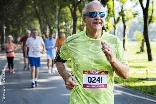 Mature runners running in a race