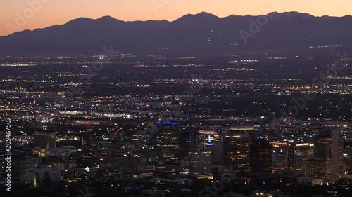 Lights shine in the Salt Lake City skyline at dusk.