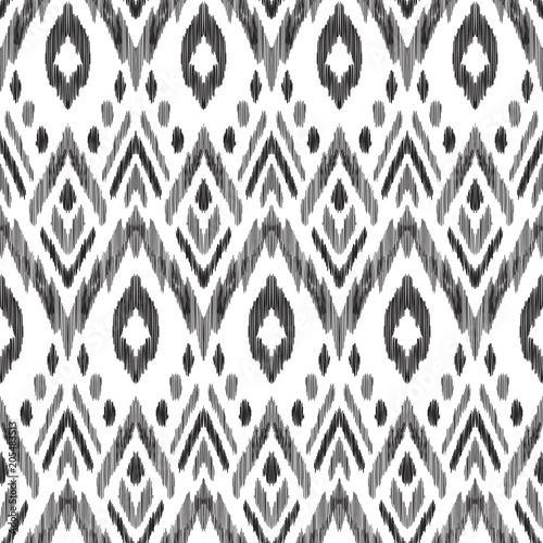 Fototapeta Tribal pattern. Seamless background. Scribble texture. Black and white graphic design. Creative vector illustration. Ethnic boho ornament. Impressive fashion print.