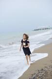 beautiful teen girl near the sea. littered the horizon