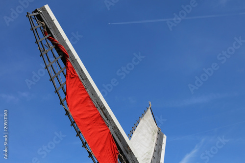 Fotobehang Rotterdam red shovel of a windmill and the sky of Holland