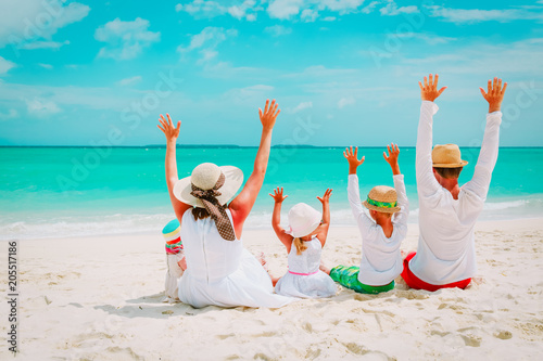 happy family with kids hands up on beach - 205517186