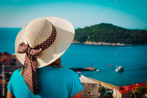 young woman travel in Croatia, looking at Dubrovnik