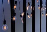 Light bulb incandescent hanging decorated interior room. - 205526106