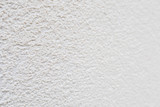 Pattern of white rock plastered stucco wall - 205531768