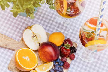 Top view of summer dinks, fruit cocktails on white wood table wi