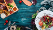 Assortment of healthy food. Cold and hot snacks. On a wooden background. Top view. Copy space.
