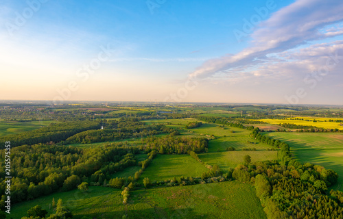 Fotobehang Blauwe hemel aerial view of meadows and field in mecklenburg western pomerania