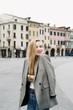 Beautiful blonde young student hipster tourist girl in the city during summer period