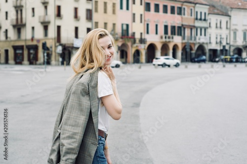 Wall mural Beautiful blonde young student hipster tourist girl in the city during summer period