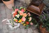 Botanic bridal chic. Beautiful bouquet of spring seasonal flowers with silk ribbons. - 205576954
