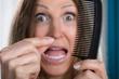 Shocked Woman Losing Hair - 205600569
