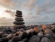 Quadro Stones balance on beach