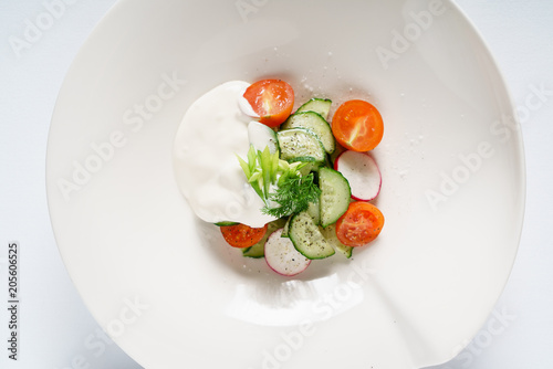 fresh salad with sour cream