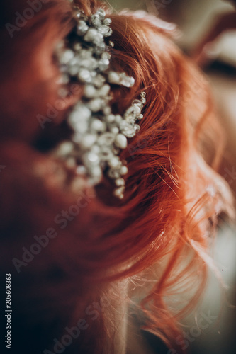 Fotobehang Kapsalon wedding hairstyle wreath detail. pearls and stone on red hair, professional styling, rustic wedding morning preparation. space for text. luxury bride