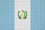 Guatemala flag  is depicted on a folded puzzle