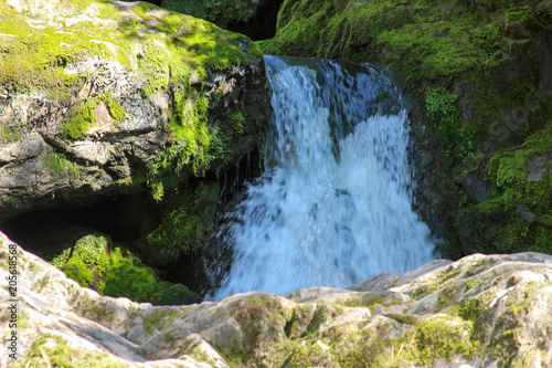 Fotobehang Zomer Rocky landscape with a waterfall. Mountain Altai Russia