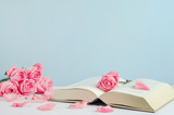 Vintage withered pink pastel rose flowers with open book - 205620311