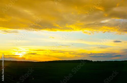 Fotobehang Oranje Sunset outside the city