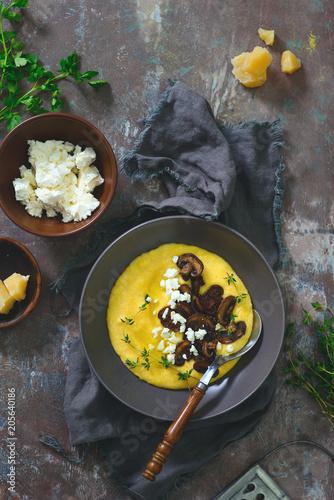 Cheesy corn porridge with mushrooms, overhead view